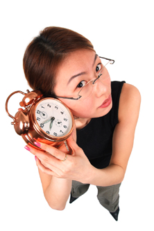 Girl with clock by ear.
